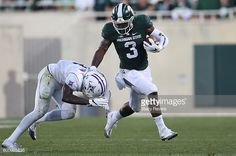 News Photo : Lj Scott of the Michigan State Spartans is...