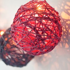 How to create a twine ball light garland. Cool idea to put in the fireplace instead of hanging it up
