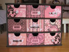 KaiserCraft Drawers. Scrapbook covered and handles and knobs added.
