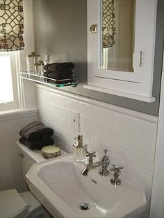 "benjamin moore greystone - this is the color - Revere Pewter looked too much like ""navajo white"" contractor boring color in my house- So this is a couple shades darker in the same warm tones - it looks great in this bathroom w/the white and brown accents"