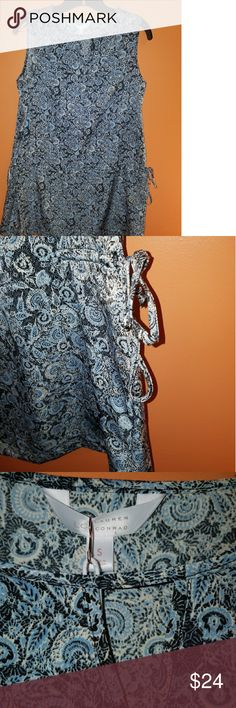 NWT LC Sleeveless Tunic in Blue Paisley NWT Lauren Conrad sleeveless tunic in a pretty blue paisley.  Ties at waist to adjust flowiness of shirt. Size small Lauren Conrad Tops Tunics