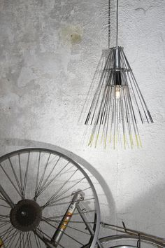 Hanging lamp made out of reclaimed bicycle wheel - for the cycling enthusiast or industrial decorator | Transfoshop, €100.00