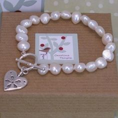 White frashwater pearls with a silver scandinavian style heart drop. The bracelet fastens with a silver toggle and measures approx 19.5cm inc the toggle, the heart measures approx 1.5cm across by 2cm down (inc the suspension loop).    Please note that the pearls will naturally vary and therfore there may be slight differences between bracelets. Temple Jewellery, Silver Pearls, Scandinavian Style, Precious Metals, Drop, Jewels, Note, Gemstones, Heart