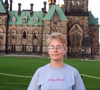 Meet Some Systers: Everything Technical: This Syster is also a BSD blogger. She sports her ITtoolbox t-shirt in front of the parliment building of her hometown of Ottowa, Canada. Ottowa Canada, Meet, Building, Sports, Hs Sports, Buildings, Excercise, Sport, Exercise