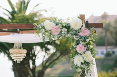 Romantic floral arch decor with a chandelier