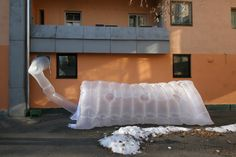 paraSITE - Ljubljana. Artist Michael Rakowitz created small, collapsible, double-membrane shelters that use the escaping warm air from a building's HVAC system to inflate and warm the temporary home.