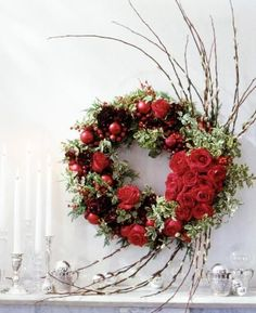 This wreath was featured on the December 2003 cover of Midwest Living with juniper, cranberries and two varieties of fresh roses. For details : http://www.midwestliving.com/homes/seasonal-decorating/holiday-rose-wreath/