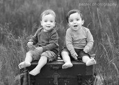 Kids on an old trunk or suitcase