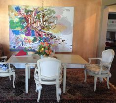 Client's current dining room. Keep wall color, art and framing of chairs as inspiration