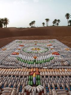 WE MAKE CARPETS, the brainchild of Dutch art collective Marcia Nolte, Stijn van der Vleuten and Bob Waardenburg, the Dutch trio who assembles everyday household items into art installations that resemble carpets. So products that normally have no value once they have been used, such as plastic forks, cups, bottles, plasters, pasta, cotton balls and pegs are creatively arranged in a rigorous style to form ornamental graphic patterns.