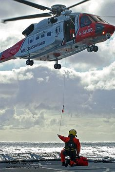 A Sikorsky S-92 Search and Rescue (SAR) helicopter operated by HM Coastguard, conducts winching drills over the flight deck of Type 23 Frigate HMS Argyll.