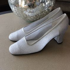 Silver Shoes sz 7 1/2 Apostrophe shoes silver with tiny silver dots all over . In good condition and Bly worn a few times there is a tiny spot on back shown in pic . Apostrophe Shoes