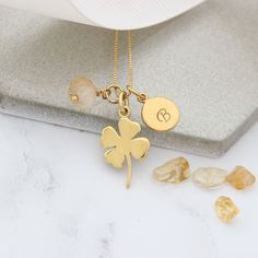 A shiny gold 4 leaf clover necklace personalised with initial charm and November birthstone gemstone to create a unique good luck gift for someone who needs a bit of good fortune. Topaz Jewelry, Jewellery, Good Luck Gifts, Good Luck Necklace, November Birthday, Clover Necklace, Golden Necklace, Leaf Clover, Initial Charm