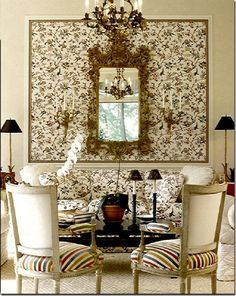 Alessandra Branca; interesting technique of using the same fabric on the pillows and the wall; it is a striking effect with the mirror and sconces.