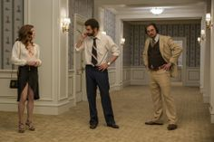 Sydney Prosser as Amy Adams, Richie Dimaso as Bradley Cooper and Irving Rosenfeld as Christian Bale in Columbia Pictures' AMERICAN HUSTLE. Photo by:  Francois Duhamel