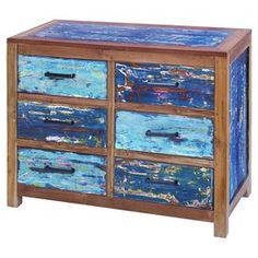 "Artistic wood chest with six drawers.Product: ChestConstruction Material: WoodColor: MultiFeatures:Ample storage capacityExceptionally sturdy and hard-wearingSix drawersDimensions: 32"" H x 40"" W x 18"" D"