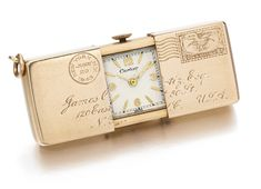 Cartier - A FINE PINK GOLD LETTER-FORM PURSE WATCH CIRCA 1943 OH WOW