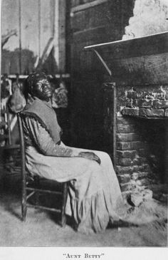 Aunt Betty.  She was the slave of Mr. Walker, at Faunsdale, and was the  cook for Rev. Mr. Harrison, Rector of St. Michael's.  The picture, taken  in Aunt Betty's home, shows a typical cabin interior. circa 1915
