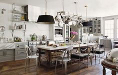 Love this kitchen, but way over-staged.  I'd sure hate to be the person responsible for keeping it clean and shining.
