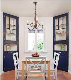 Built-in, floor to ceiling, corner kitchen hutch. Open middle.