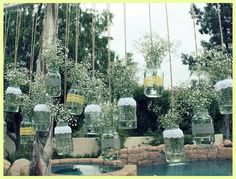 Mason jars with ribbons wrapped in the shower colors and some white baby's breath inside them..perfect for an outdoor shower!