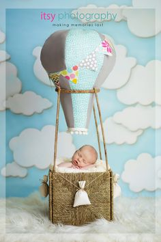 Such a cute baby in a Hot Air Balloon!  Great for your birthday party travel theme, nursery travel theme, oh the places he'l go decor, oh the places she'll go, newborn baby in a hot air balloon prop, aviator hat and hot air balloon basket.