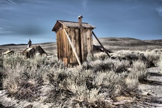 The famous W/C in Bodie State Historic Park, California. Ghost mining town El. 8375,Bodie is located in the eastern slopes of the Sierra, close to the Nevada border. It can be righteously hot by midsummer and buried in snow in wintertime. Started when William Body found gold in 1859. Nuggets in here?