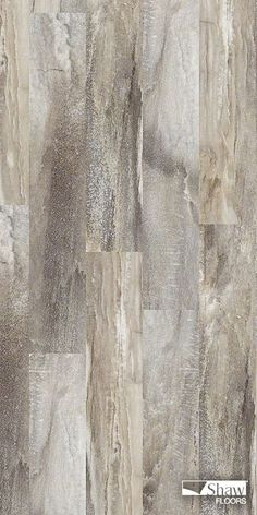 A visual fusion of stone and wood, 'Easy Style,' a resilient vinyl plank, makes simple décor shine. Pictured in the color Five Spice.
