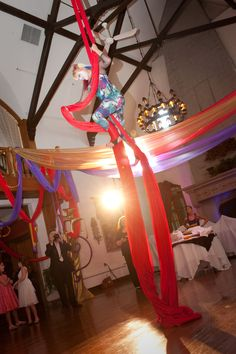 Guests were led into a room with a real cirque performer hanging on silks! Find us on Facebook! Impressive Invites and Events