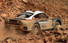 Feature Story by Wallace Wyss Yes, it's true, and I am sure most Porsche 911 owners would faint dead away if you proposed rocketing their car across the open desert. But the Porsche Rally variant o… Le Mans, Sport Cars, Race Cars, Rallye Paris Dakar, Rallye Raid, Rear Wheel Drive, The Dunes, Rally Car, Ferdinand