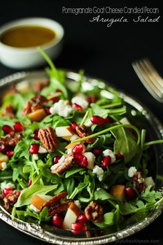 Pomegranate Goat Cheese Candied Pecan Arugula Salad. The perfect salad to change up your holiday menu, easy to make and absolutely delicious! | www.joyfulhealthyeats.com