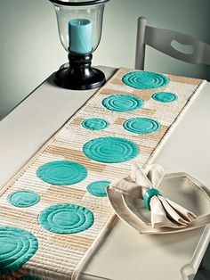 Turquoise and earth tones, circles ... table runner, cushion covers, other ...