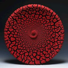 Red crawled glaze disc sculpture