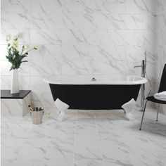 The Carrara Marble Effect range from Tile Mountain, less than half the price on the high street. Get free samples: same day dispatch - receive your tiles tomorrow! Minimal Bathroom, Classic Bathroom, Small Bathroom, White Porcelain Tile, White Marble Bathrooms, Monochrome Interior, Classic Baths, Traditional Baths, Black Bath