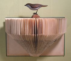 I think I'm going to head out to my local second hand store and look for a couple of good old books to make into shelves. The only difference is that I will probably add a support to the top of the shelves. Folded Book Art, Paper Book, Book Folding, Paper Folding, Paper Art, Cut Paper, Book Page Art, Book Pages, Altered Books
