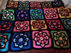 Stained glass granny square pattern, from http://www.ravelry.com/patterns/library/julieannys-stained-glass-afghan-square