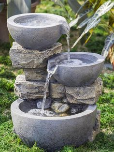 Water dances from tier to tier int he rock and pot water fountain