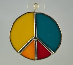 Peace sign - yellow orange red teal