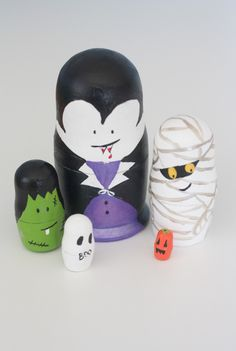So, as you know, I'm totally geeking out over Halloween. Honestly, I can't stop. But I have started limiting myself, and my new rule is I can only make things out of supplies I ALREADY have. I bought 3 sets of these unpainted nesting dolls almost a year ago. I had grand plans to use them as Christmas gifts, but …