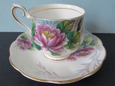 Royal Albert Water Lily Tea Cup, Saucer. 1950s Hand Painted, Gilded, Pink Water Lily, Flower of the Month series No 7, Hampton Shape tea cup saucer, teacup. July birthday gift. Note: I have another in the series, Cosmos and will combine shipping for significant savings. Dimensions: