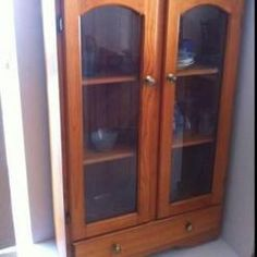 Pine china cabinet with glass doors.    Price: $100.00