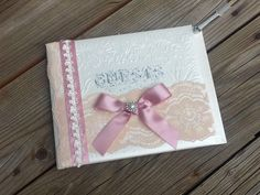A personal favorite from my Etsy shop https://www.etsy.com/listing/281633744/lace-blush-pink-and-ivory-guest-book