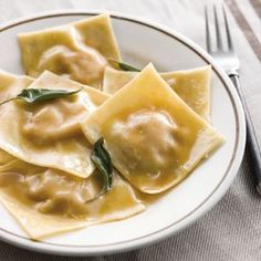 Pumpkin Ravioli with Sage Butter Recipe - Made this for a dinner party WITHOUT a pasta machine. Doable, but time consuming. Tasted yummy, though. Pumpkin Recipes, Fall Recipes, Savory Pumpkin Ravioli Recipe, Recipes Dinner, La Trattoria, Pasta Recipes, Cooking Recipes, Rice Recipes, Healthy Recipes