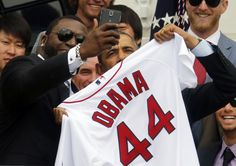 """President Obama poses with David Ortiz for a """"selfie"""" as he welcomes the 2013 World Series Champion Boston Red Sox to the South Lawn of the White House in Washington, April 1, 2014. REUTERS/Larry Downing"""