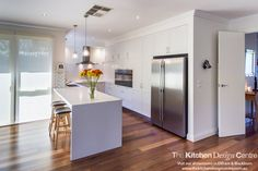 A beautiful white kitchen with a herringbone tile splashback and clever storage throughout. www.thekitchendesigncentre.com.au @thekitchen_designcentre