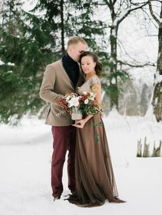 loving couple in the winter forest with flowers