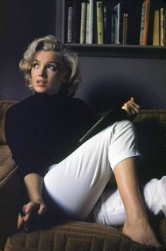 Marylin Monroe, black top and white pants. Yep