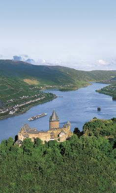 The ultimate river travel experience: Sailing on a Viking longship under Stahleck Castle – one of the many sites to see in Germany on the Rhine.