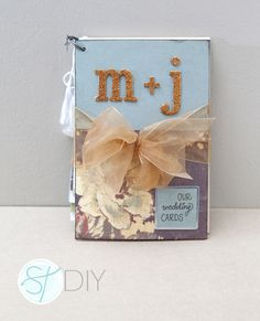 Did you get a lot of wedding cards?  Do you want to hold on to them, but want them to be organized and nicely displayed? Make a book out of them!