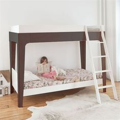 The Perch Bunk Bed from Oeuf features a modern and sleek silhouette with all of the functionality needed in a kid's bunk bed